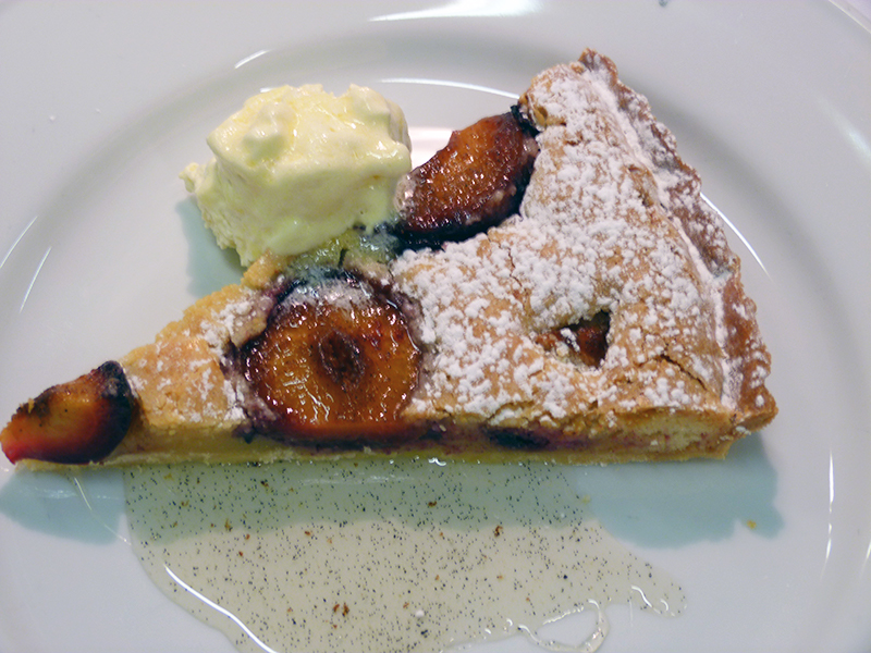 Plum and almond tart with crème fraise